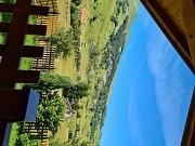 Двухэтажный деревянный дом на большом земельном участке рядо Kolasin